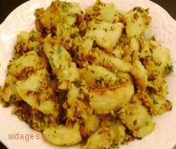 Πατάτες με κάρυ και κύμινο - www.sidages.gr